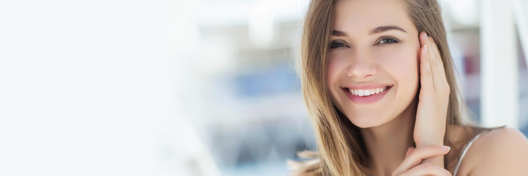 girl smiling after cosmetic dentistry appointment
